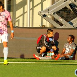 June 25, 2019 - Madison, Wisconsin, United States - Minnesota United forward Abu Danladi (99) is tended to for an injury during the Forward Madison FC vs Minnesota United FC friendly match at Breese Stevens Field.