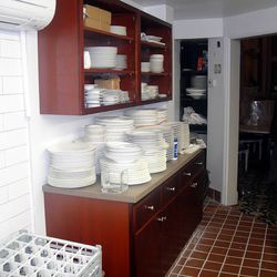 The updated kitchen has a new plate and coffee service station.