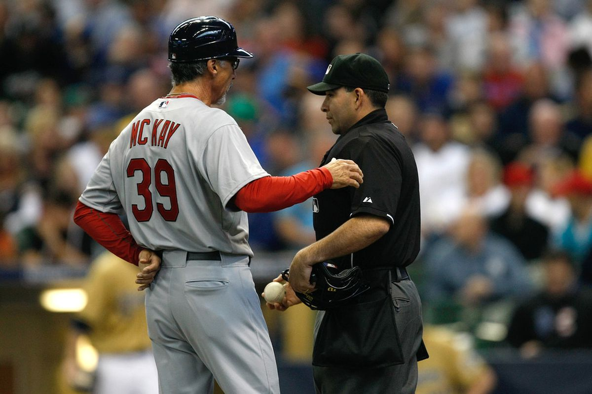 Coach Dave McKay of the St. Louis Cardinals argues with umpire Angel Campos against the Milwaukee Brewers at Miller Park in Milwaukee, Wisconsin. McKay will be the Cubs' first base coach in 2012. (Photo by Scott Boehm/Getty Images)