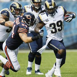 St. Louis Rams running back Steven Jackson (39) is chased by Chicago Bears linebacker Brian Urlacher (54) in the second half of an NFL football game in Chicago, Sunday, Sept. 23, 2012. The Bears won 23-6.
