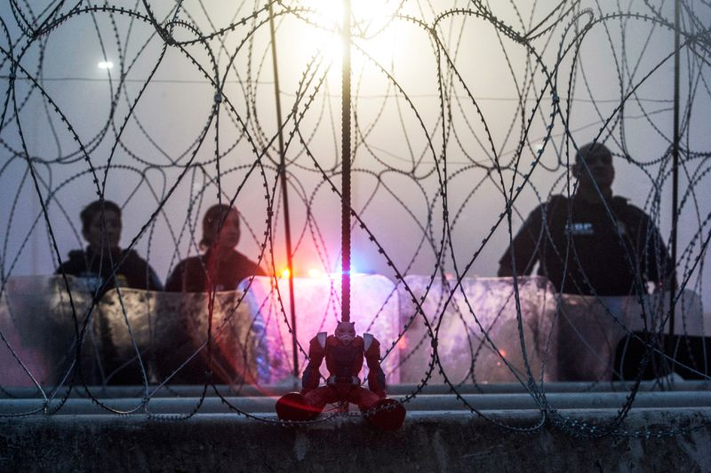 A toy is seen from Piedras Negras, Mexico on the border fence as members of the US Border Police guard the international bridge in Texas, on February 6, 2019.