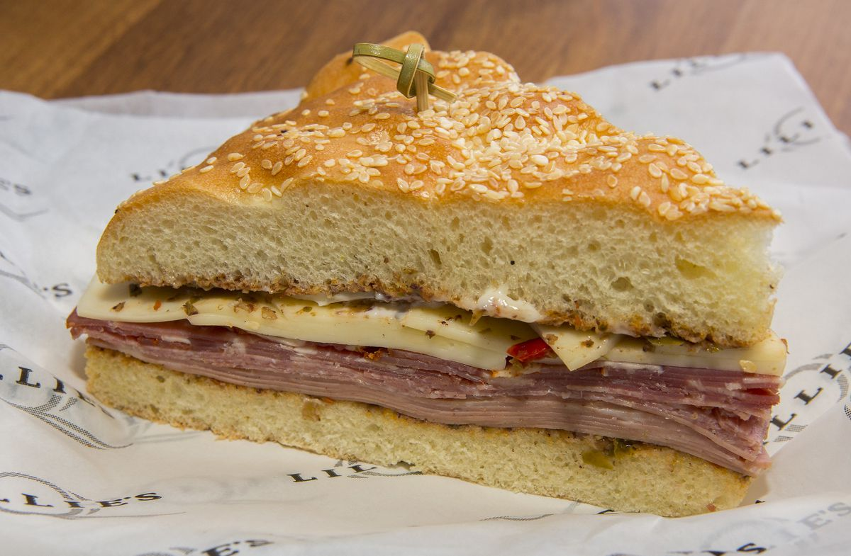 A muffaletta with pork and cheese.
