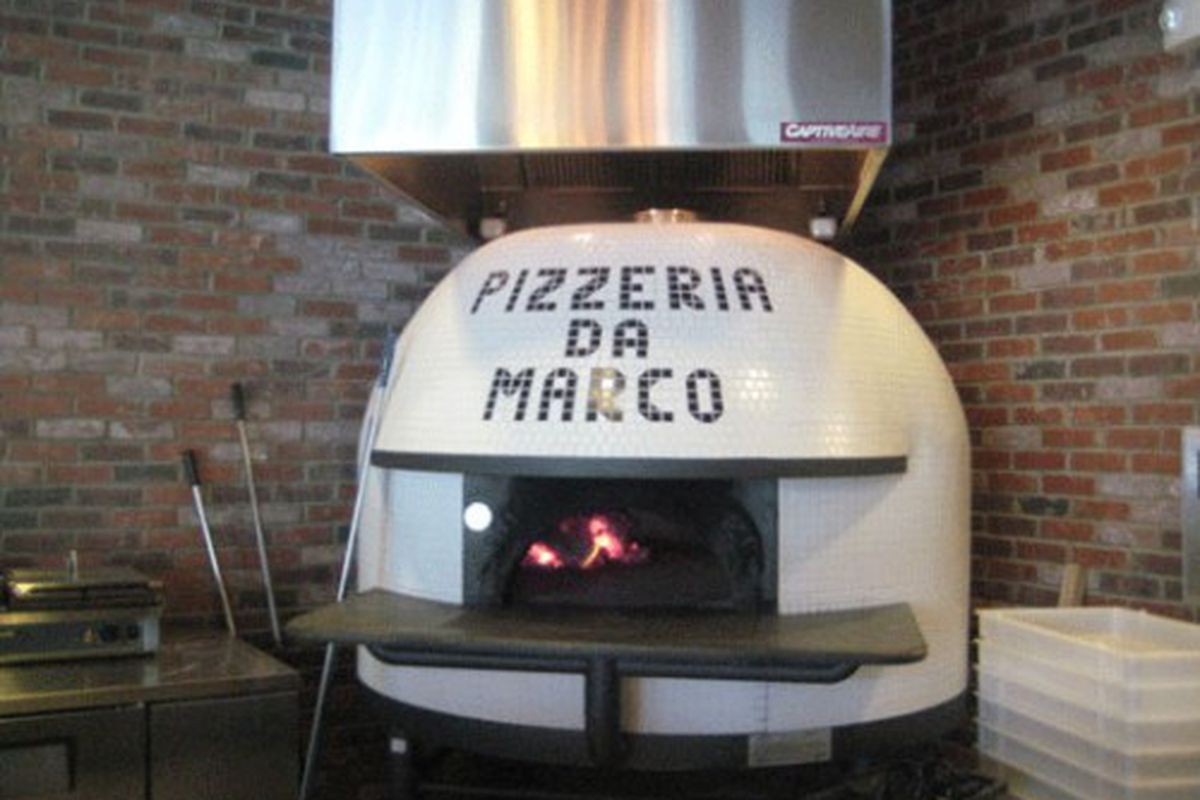 Pizzeria Da Marco's central feature is a Stefano Ferrara brick oven, imported from Naples, that cooks a pizza in 60 seconds.