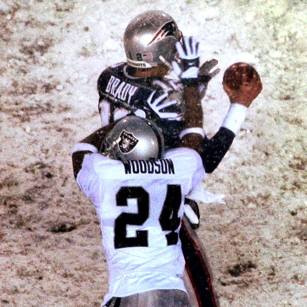 Raiders defensive back Charles Woodson makes contact with Brady to initiate the fateful play (Matthew J. Lee/The Boston Globe via GettyImages)