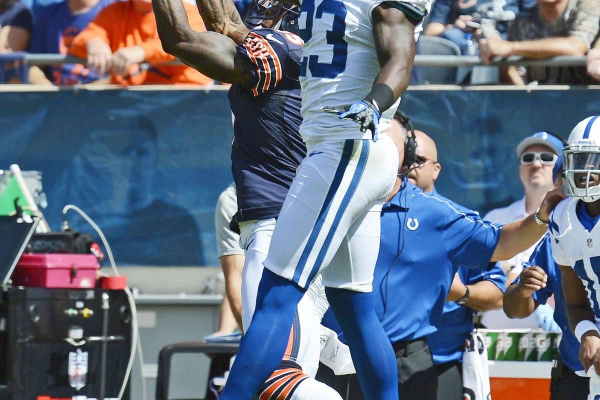 Sep 09, 2012; Chicago, IL, USA; Chicago Bears wide receiver Brandon Marshall (15) attempts to make a catch over Indianapolis Colts defensive back Vontae Davis (23) during the second quarter at Soldier Field. Mandatory Credit: Mike DiNovo-US PRESSWIRE