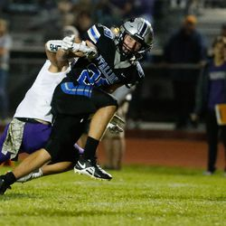 Stansbury's Dylan Hamilton (20) gets pressured by Tooele defense during a high school football gameat Stansbury High School in Stansbury Park on Friday, Sept. 17, 2021.