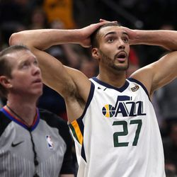 Utah Jazz center Rudy Gobert (27) watches a replay during a basketball game against the New York Knicks at the Vivint Smart Home Arena in Salt Lake City on Friday, Jan. 19, 2018.