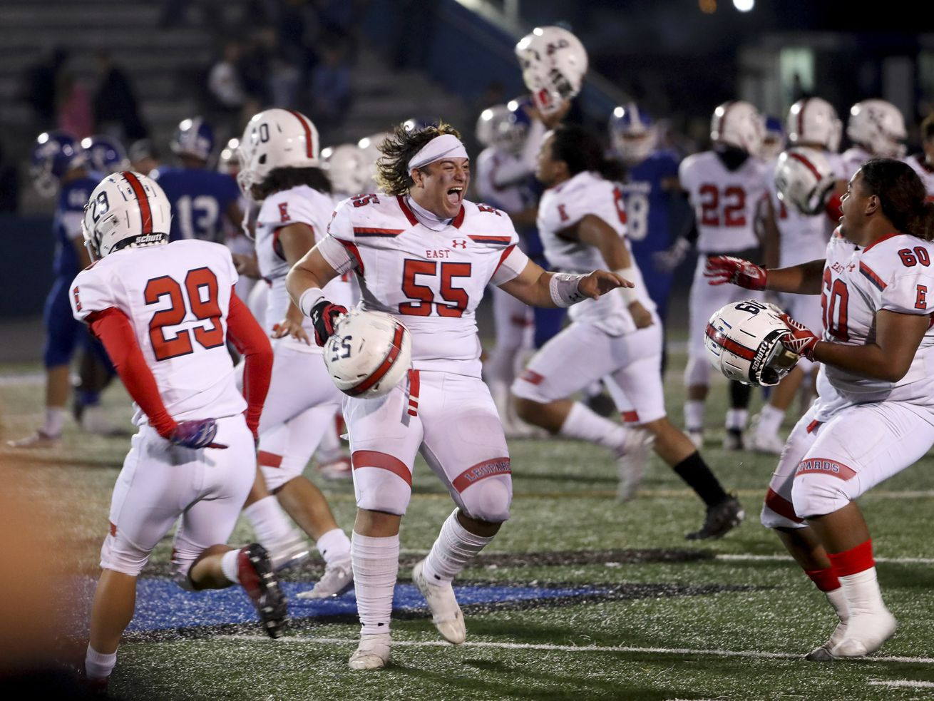 East's Tuiono Tuiaki (55) screams with excitement as the Leopards storm the field after defeating Bingham in the 6A football quarterfinal game at Bingham High School in South Jordan on Friday, Nov. 8, 2019.