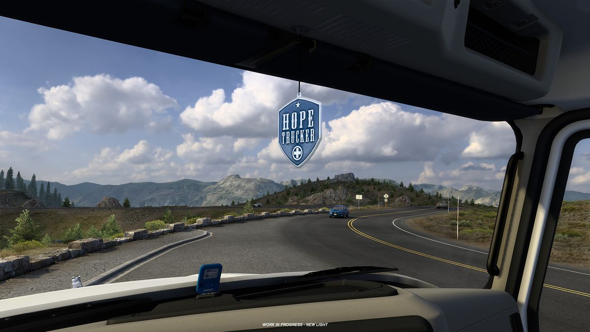 interior cab view in American Truck Simulator. the driver appears to be cooling their brakes by a scenic overlook as oncoming traffic approaches