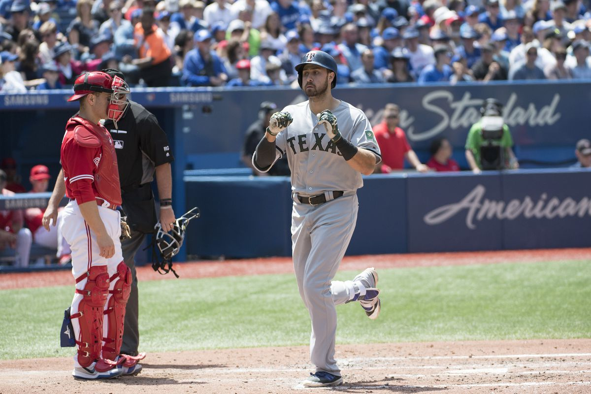Travis hits grand slam, Blue Jays beat Rangers 7