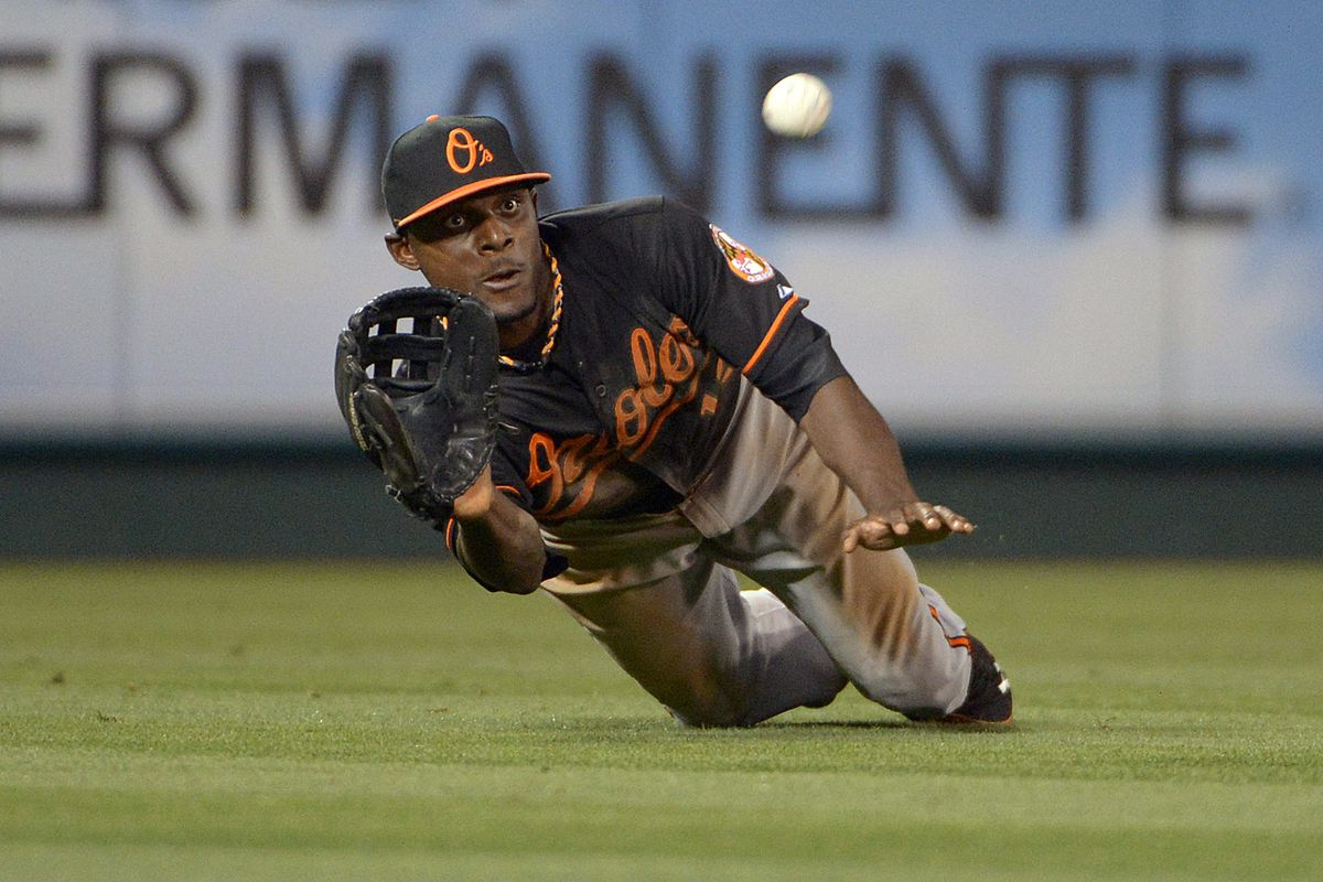 Xavier Avery catches a fly ball of the bat of Macier Izturis on July 6, 2012 in Anaheim, CA