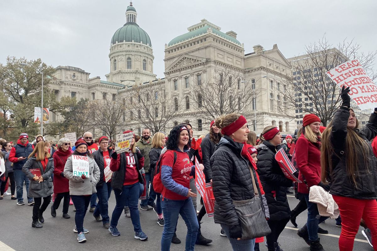 Red for Ed supporters march up Capitol Avenue around the Indiana Statehouse on Tuesday, Nov. 19, 2019.
