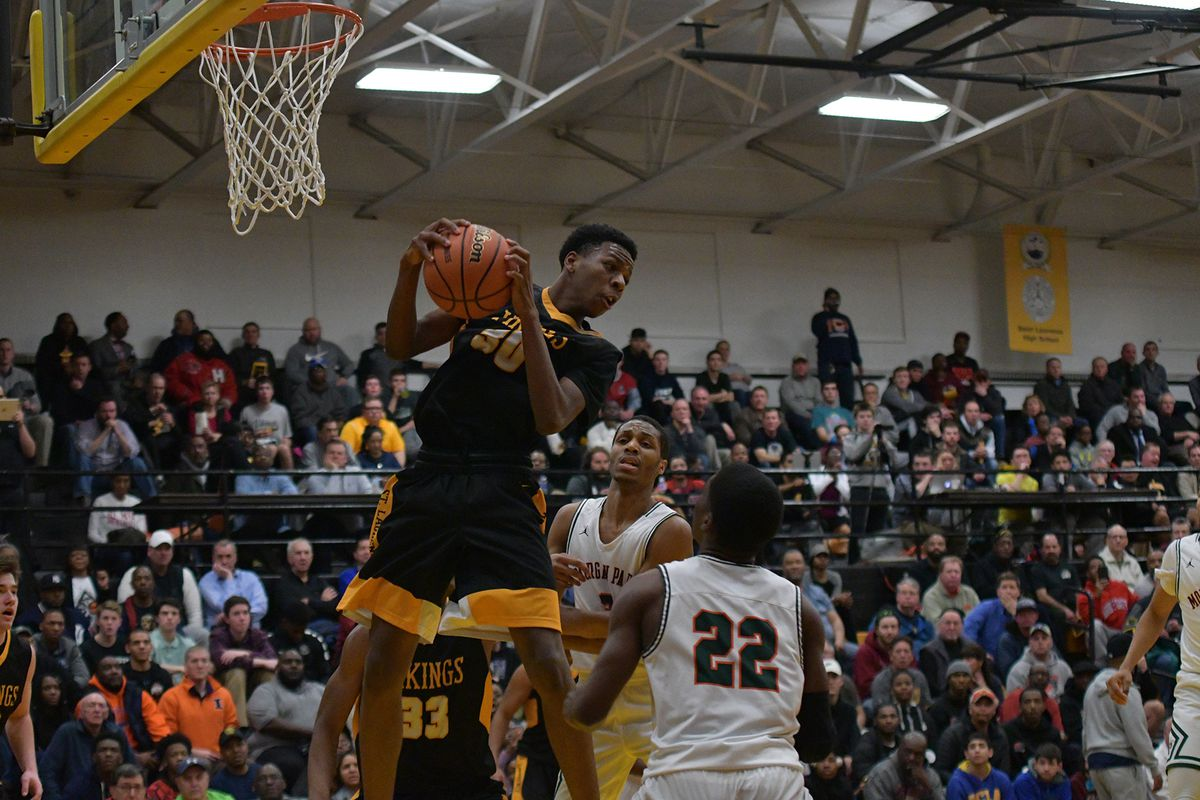 St, Laurence's Jeremiah Williams (30) hauls in a rebound against Morgan Park.