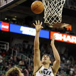Utah Jazz center Enes Kanter (0) shoots over Portland Trail Blazers center Robin Lopez (42) in the second half of a game at the Energy Solutions Arena on Wednesday, October 16, 2013.