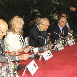 From left, France's foreign minister Alain Juppe, U.S Foreign Secretary Hillary Clinton, and Egyptian counterpart,  Mohamed Kamel Amr,  UAE's  Mohamed Anwar and ambassador of United Kingdom Peter Ricketts, right, at the round table with their delegations in Paris Thursday, April 19, 2012. Juppe said two main questions will be on the table at the Paris meeting, attended by Arab countries like Saudi Arabia, U.N. Security Council member Morocco and Qatar, plus Western powers like the U.S., Britain and Germany.
