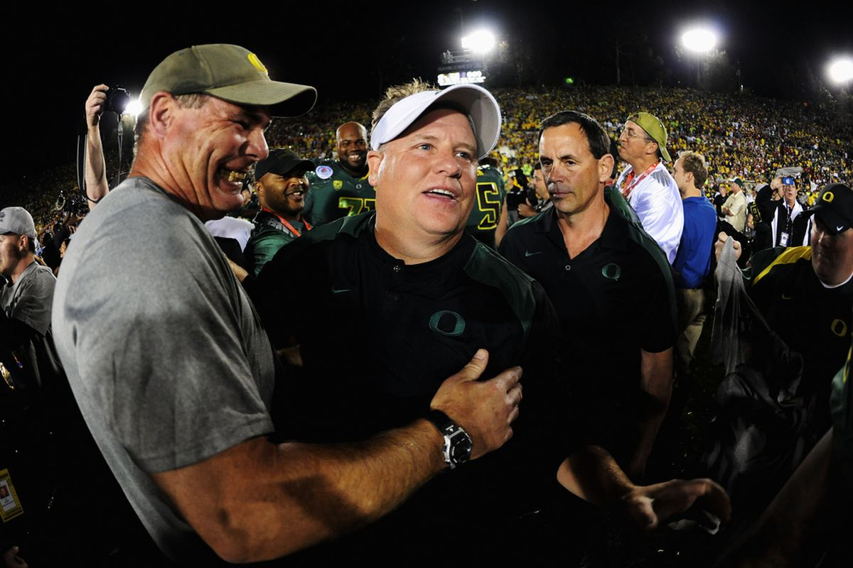 PASADENA, CA - JANUARY 02:  Head coach Chip Kelly of the Oregon Ducks celebrates after the Ducks 45-38 victory over the Wisconsin Badgers at the 98th Rose Bowl Game on January 2, 2012 in Pasadena, California.  (Photo by Harry How/Getty Images)