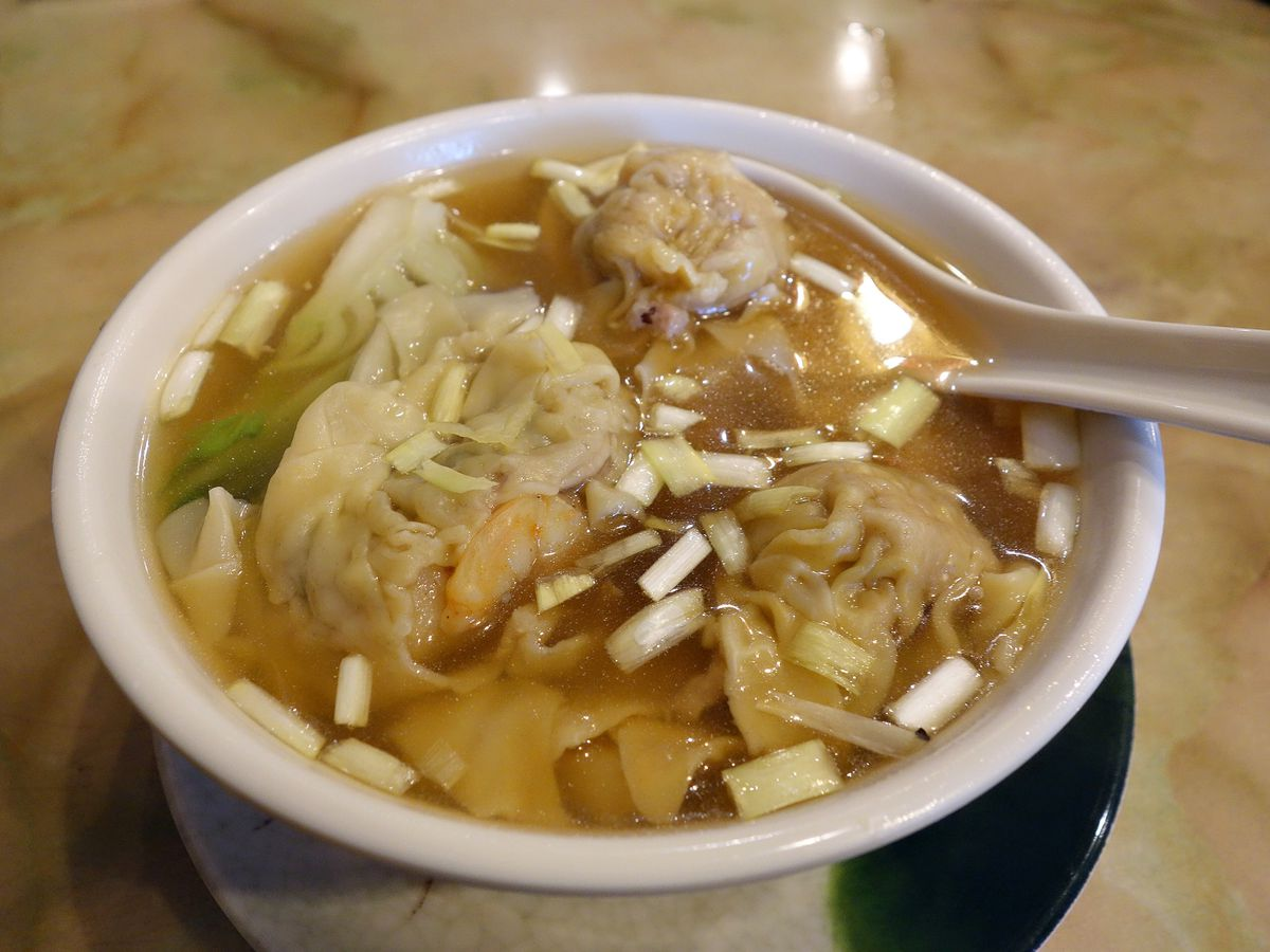 Soup with a light broth, wontons, and meat from Mike's Noodle House