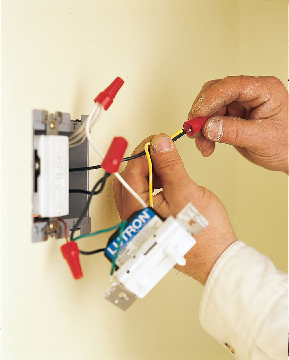 Man Connects New Dimmer Switch For Under Cabinet Lighting