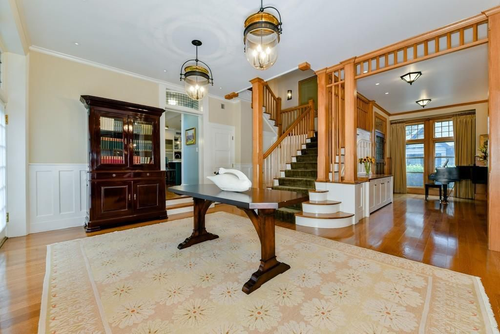 The large, capacious entry foyer with a staircase.