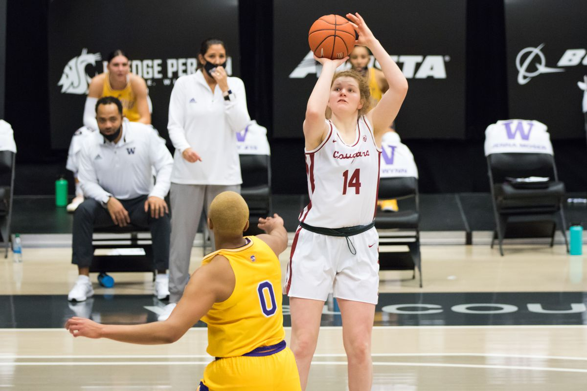 PULLMAN, WA - FEBRUARY 28: Washington State center Jessica Clarke (14) hits a pull up jumper during the first half of a Boeing Apple Cup Series matchup between the Washington Huskies and the Washington State Cougars on February 28, 2021, at Beasley Coliseum in Pullman, WA.