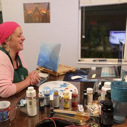 Lisa Knapp paints throughout a Zoom assembly with co-workers throughout a post-work group exercise at her dwelling in Provo on Monday, Nov. 23, 2020, the 141st day since her <a href=