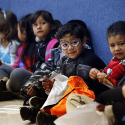 Students line up for the Breakfast in the Classroom program at Backman Elementary School in Salt Lake City on Friday, Oct. 28, 2016. At center are students Francisco and Juan.