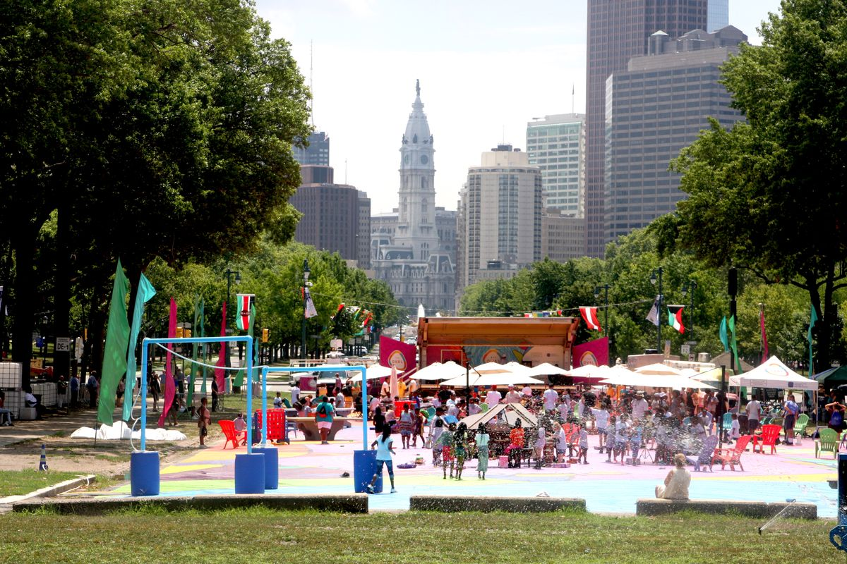 A view of the Oval pop-up park with City Hall in the background.