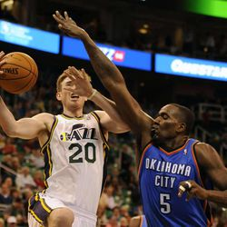 Utah Jazz small forward Gordon Hayward (20) us fouled by Oklahoma City Thunder center Kendrick Perkins (5) while driving to the basket during a game at Energy Solutions Arena on Wednesday, October 30, 2013.