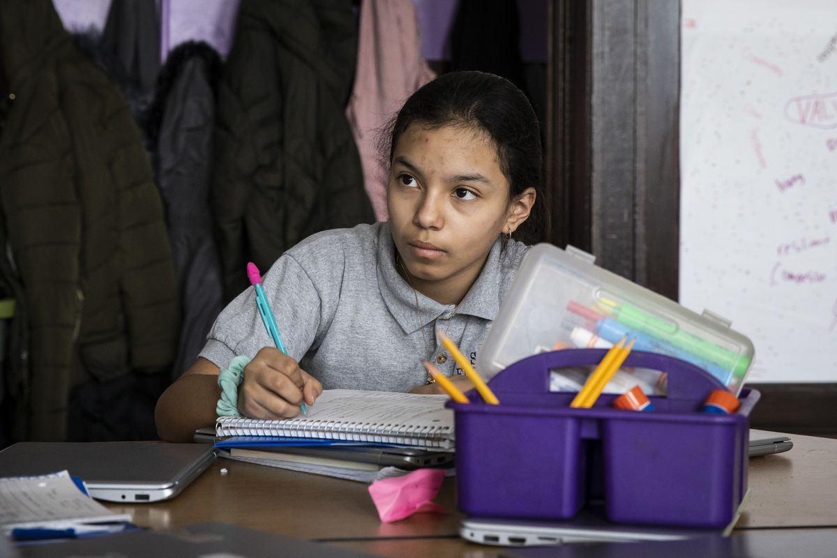 """Esmeralda Blanco, 11, a sixth grade student at Sawyer Elementary School, at 5247 S. Spaulding Ave. in Gage Park, studies the New York Times Magazine's acclaimed """"1619 Project"""" during Black History Month, Thursday morning, Feb. 27, 2020."""