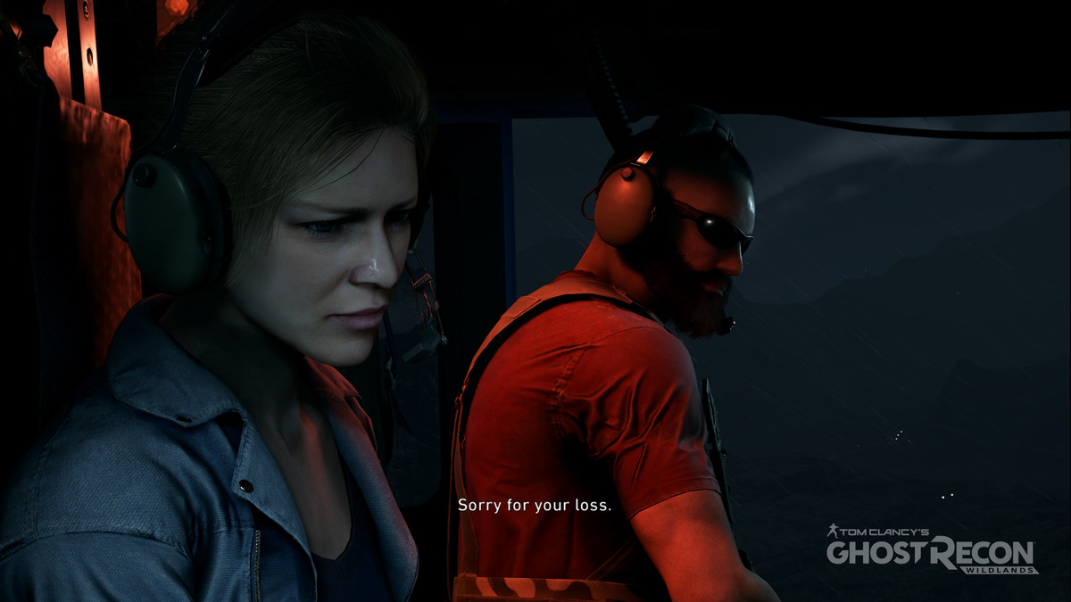 """CIA case officer Karen Bowman sits inside a helicopter with a player character. """"I'm sorry for your loss,"""" says the player character."""