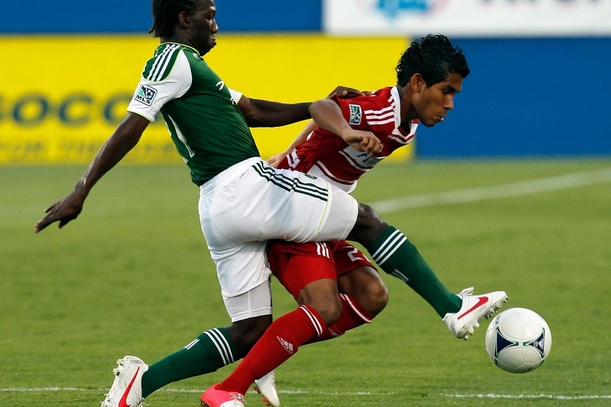FRISCO, TX - JULY 21:  (L-R) Diego Chara #21 of the Portland Timbers controls the ball against Carlos Rodriguez #22 of the FC Dallas at FC Dallas Stadium on July 21, 2012 in Frisco, Texas.  (Photo by Tom Pennington/Getty Images)