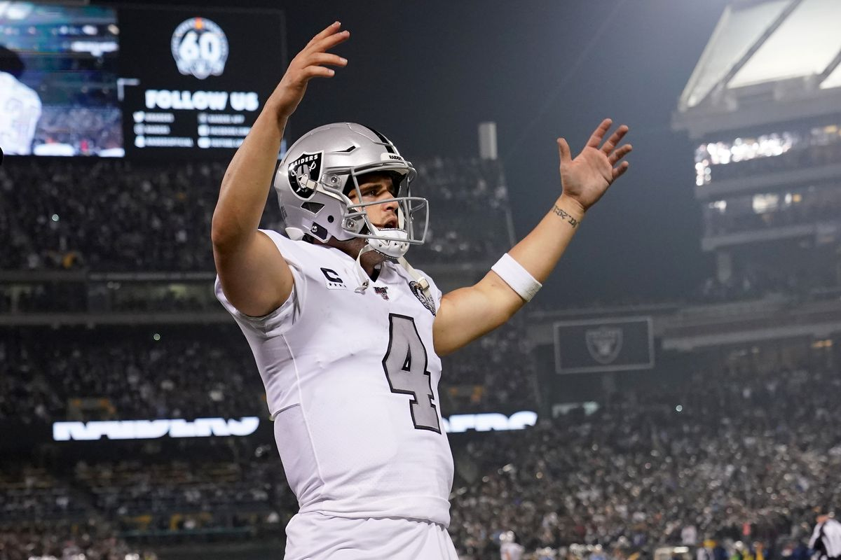 Quarterback Derek Carr of the Oakland Raiders rouses the crowd to cheer louder against the Los Angeles Chargers late in the fourth quarter at RingCentral Coliseum on November 07, 2019 in Oakland, California.