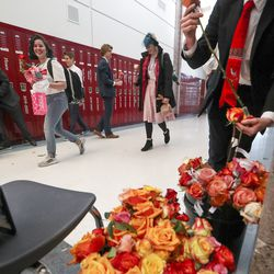 Members of the Herriman High School boys cross-country and track teams greet female classmates with a Valentine's Day rose as they arrive at school on Friday, Feb. 14, 2020. The boys decided they didn't want anyone feeling left out on Valentine's Day, so they went to work and raised enough money to buy roses for every girl at the school. The fundraising was so successful the Herriman students had enough roses to share with neighboring Riverton High School, where the flowers were also handed out to female students.