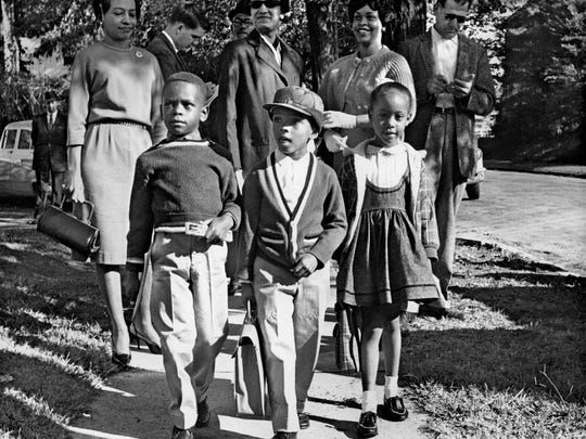 October 3, 1961 – Thirteen black first graders entered four of Memphis' previously all-white schools including Bruce School these students were attending. The children transferred to Bruce were from left; Harry Williams, 6, Michael Willis, 5, and Dwania Kyles, 5. Willis, son of prominent black attorney A.W. Willis, later changed his name to Menelik Fombi.