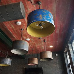 Light fixtures made from oil drums