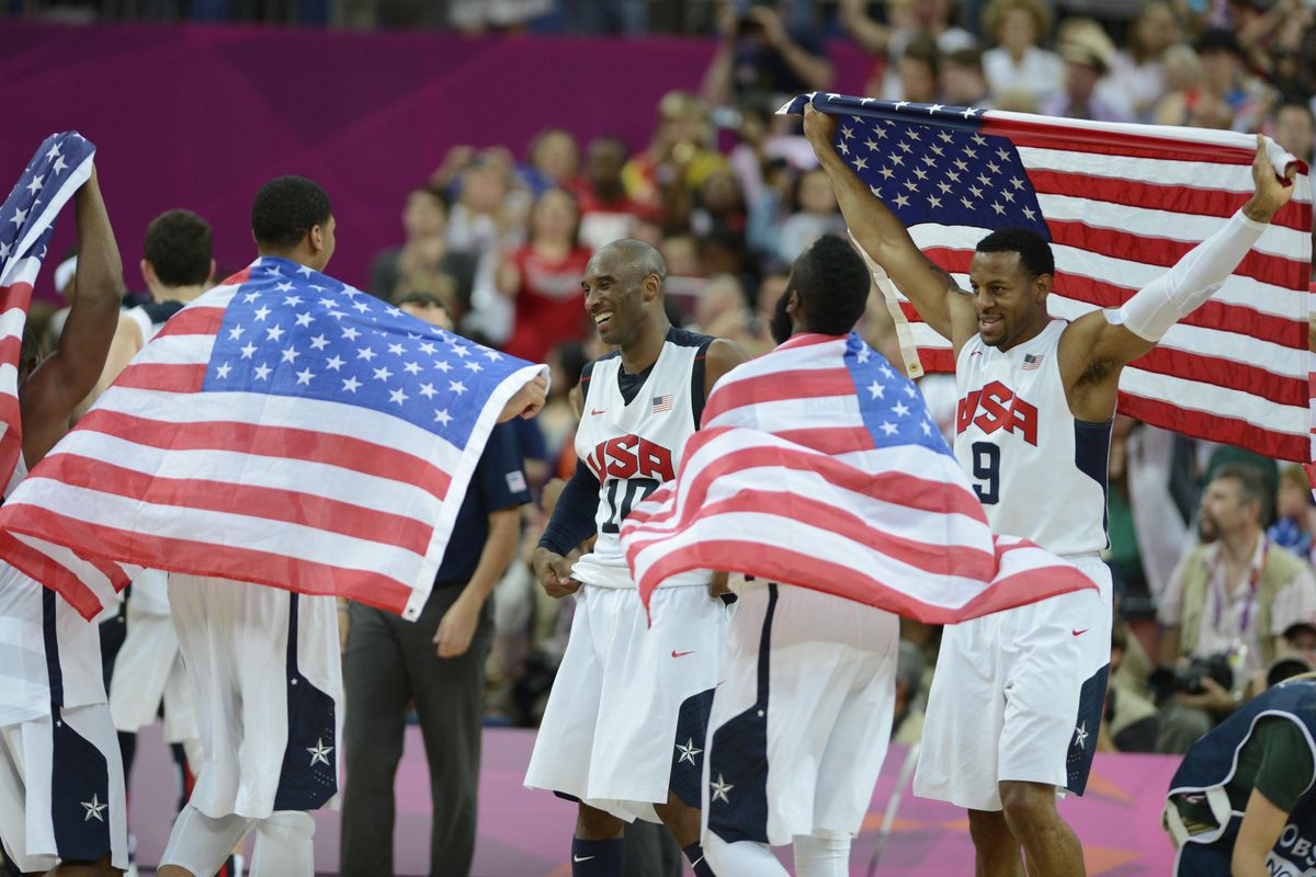 New Nugget Andre Iguodala (9) and guard Kobe Bryant (10) celebrate their gold medal victory over Spain on Sunday.