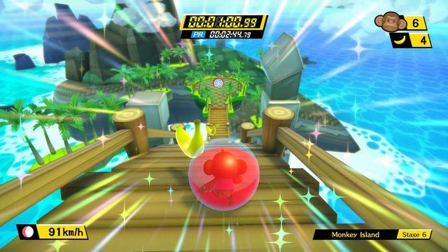 A monkey in a ball rolls down a wooden platform in a screenshot from Super Monkey Ball: Banana Blitz HD