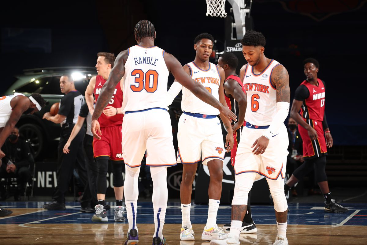 Julius Randle and RJ Barrett of the New York Knicks hi-five during the game against the Miami Heat on February 7, 2021 at Madison Square Garden in New York City, New York.