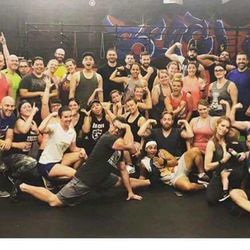 Those who attended Saturday's fundraising exercise class at Pure Workout gather for a photo afterward. The group raised about $2,000 for the family of Memorez Rackley, who was killed along with her 6-year-old son, Jase, in a shooting last Tuesday.
