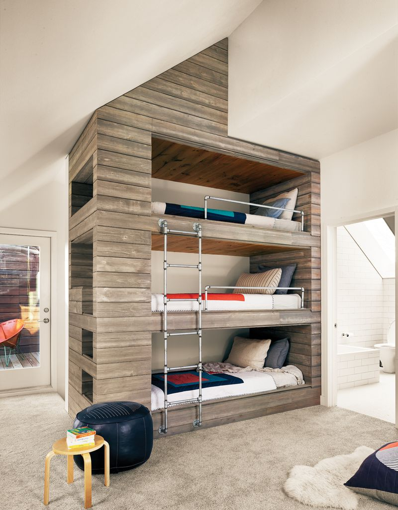 Three bunk beds stacked on top of each other.