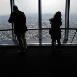 Journalists look at the view from the 450-meter (1,476 feet)-high observation deck of the Tokyo Sky Tree during a press preview in Tokyo Tuesday, April 17, 2012. The world's tallest freestanding broadcast structure that stands 634-meter (2,080 feet) will open to the public in May.