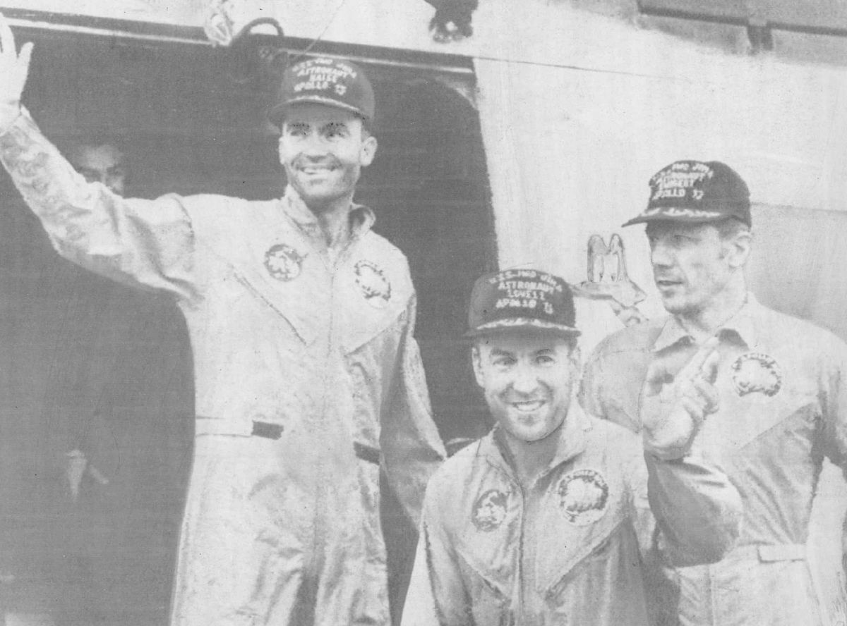 Apollo 13 astronauts Fred Haise, James Lovell, and John Swigert (left to right)leave a helicopter to step aboard the carrier Iwo Jima in the Pacific Ocean after their successful recovery. | AP