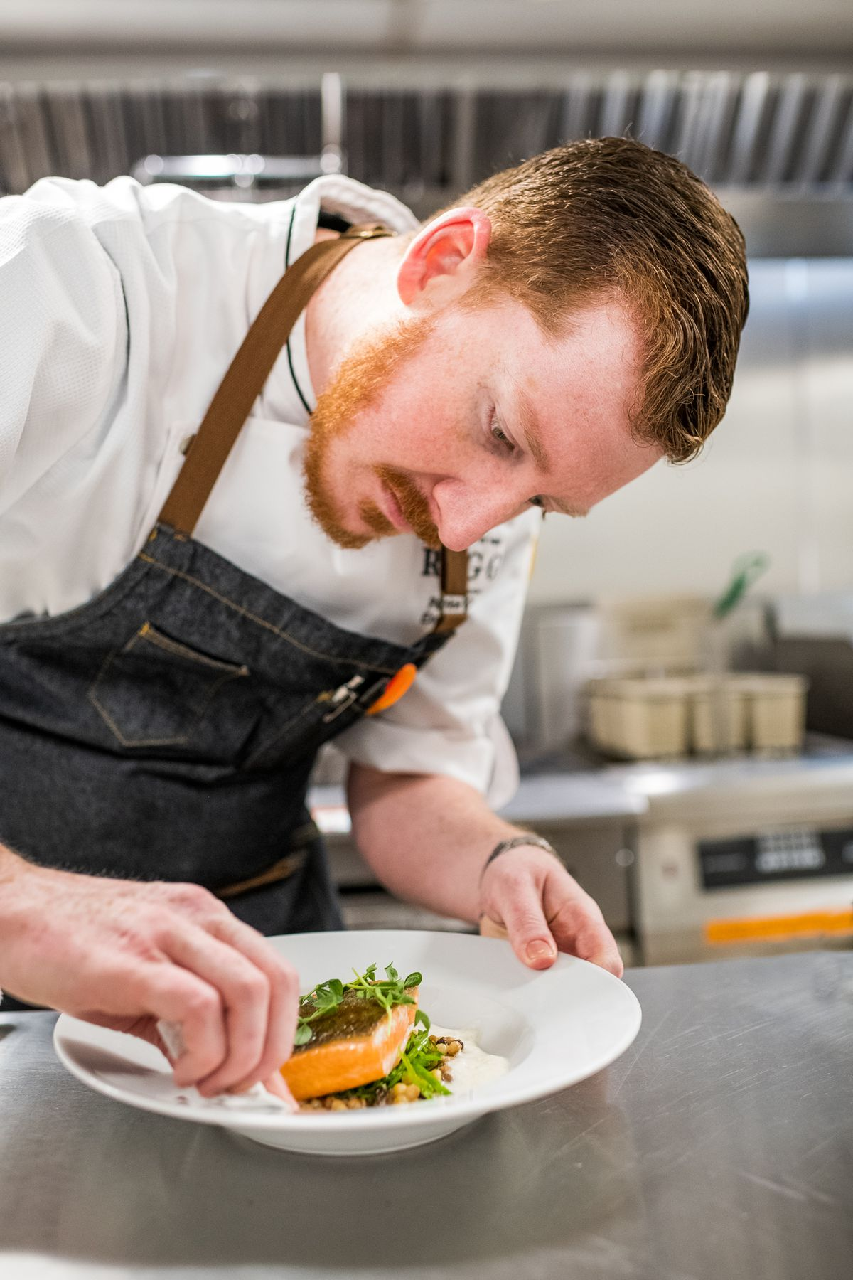 Patrick Curran plates an arctic char dish at Cafe Riggs