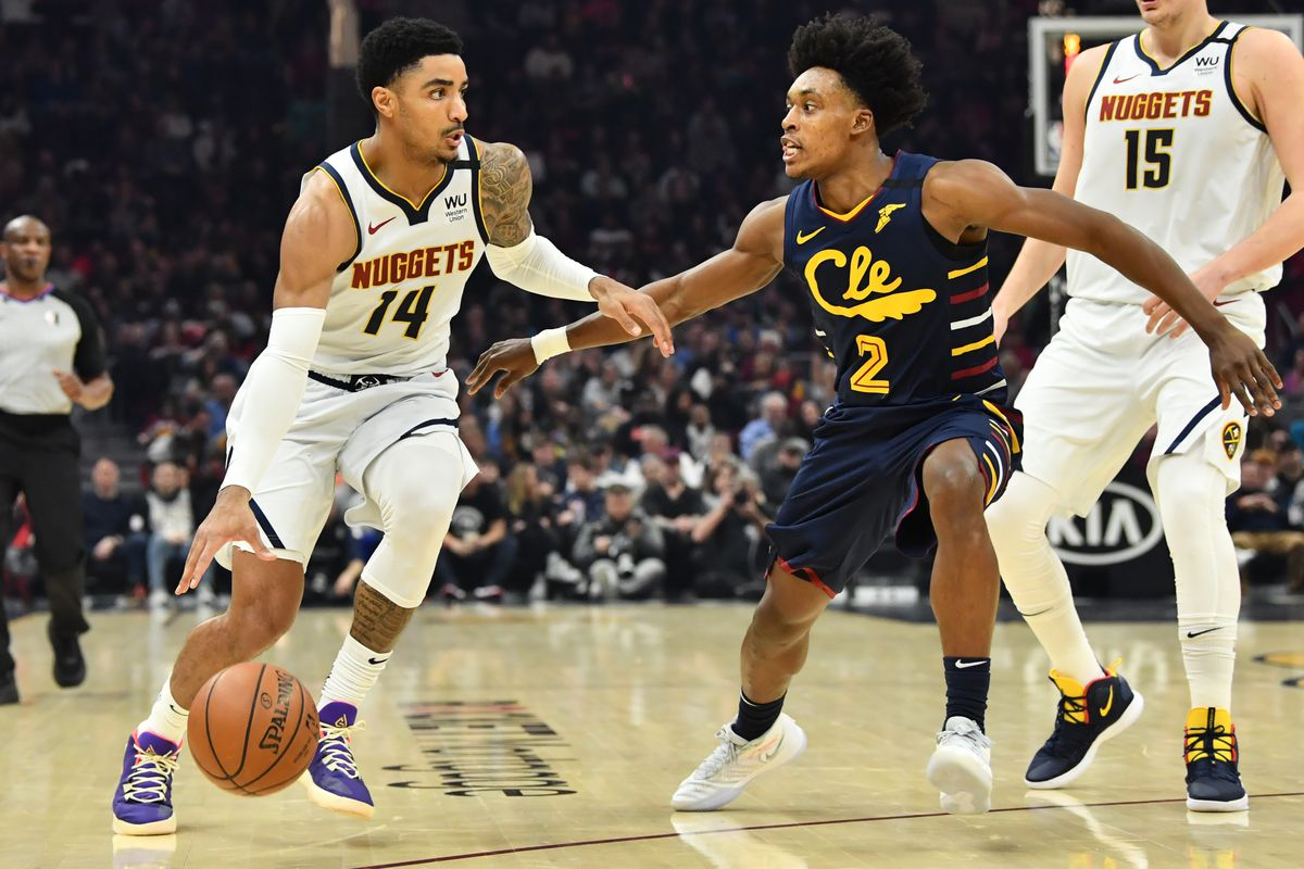 Denver Nuggets guard Gary Harris drives to the basket against Cleveland Cavaliers guard Collin Sexton during the first half at Rocket Mortgage FieldHouse.