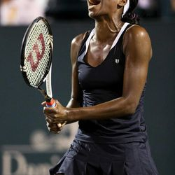 Venus Williams, of the United States, reacts to a poor shot while playing Jelena Jankovic, of Serbia, at the Family Circle Cup tennis tournament in Charleston, S.C., Wednesday April 4, 2012.