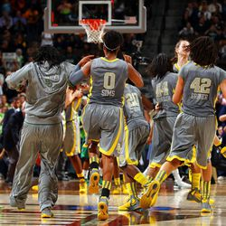 DENVER, CO - APRIL 03:  Odyssey Sims #0 and Brittney Griner #42 of the Baylor Bears celebrate with their teammates after they won 80-61 against the Notre Dame Fighting Irish during the National Final game of the 2012 NCAA Division I Women's Basketball Championship at Pepsi Center on April 3, 2012 in Denver, Colorado.  (Photo by Doug Pensinger/Getty Images)