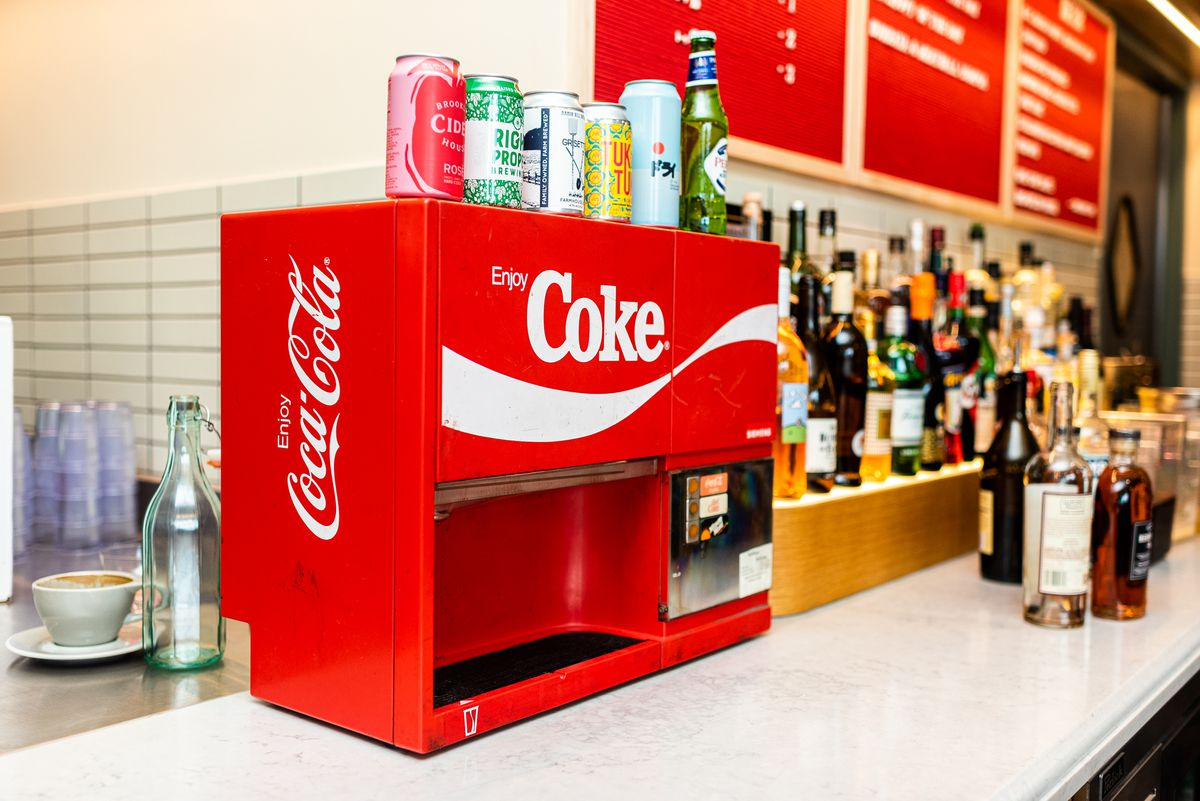 A vintage Coke machine from 1975 is stocked with spiked syrups for hard seltzer