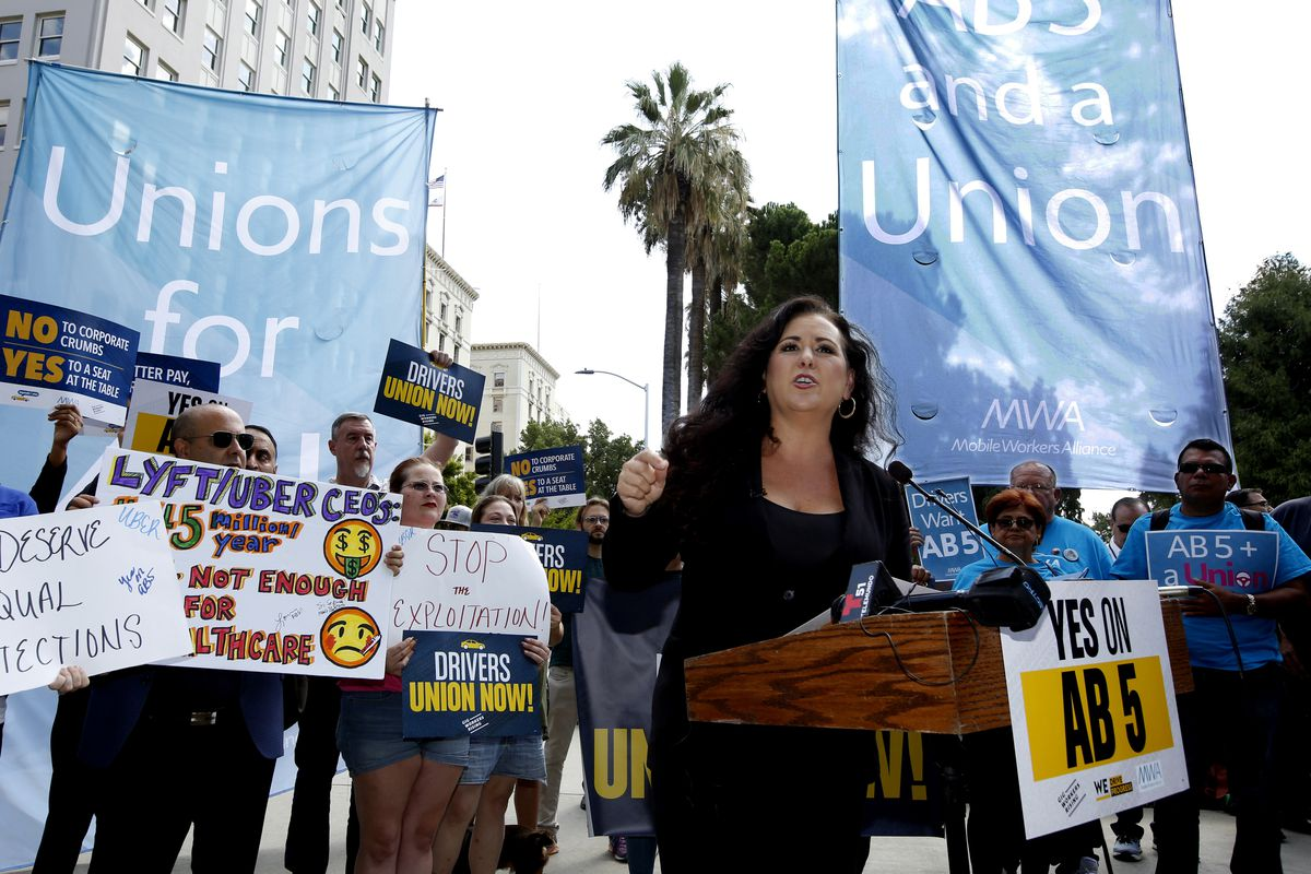 Assemblywoman Lorena Gonzalez, D-San Diego, speaks at rally calling for passage of her measure to limit when companies can label workers as independent contractors.