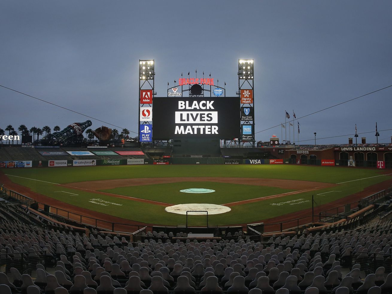 "The words ""Black Lives Matter"" are displayed on the digital screen after the postponement of the game between the San Francisco Giants and the Los Angeles Dodgers at Oracle Park in San Francisco on Thursday."