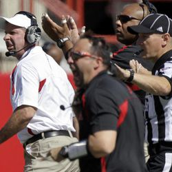 Nebraska head coach Bo Pelini, left, reacts to a play in the first half of an NCAA college football game against Arkansas State in Lincoln, Neb., Saturday, Sept. 15, 2012. Pelini left Saturday's game against Arkansas State by ambulance after falling ill on the sideline in the first half.